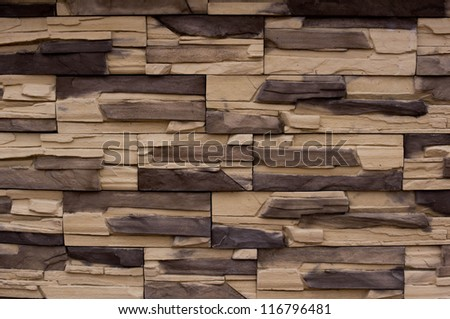 The facade of the building, built of natural stone. - stock photo