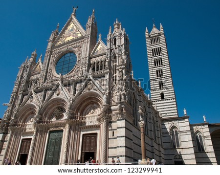 The facade of the Cathedral in Siena - stock photo