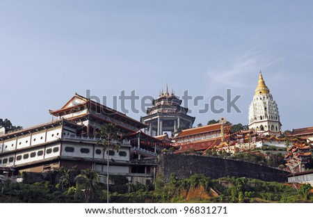 The facade of the Kek Lok Si buddhist temple perched on the hillside of Penang Hill in Air Itam, Penang, Malaysia. - stock photo