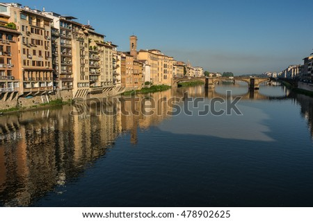 The facades of the embankment on the Arno river near the old stone bridge Santa Trinita, Florence, Italy