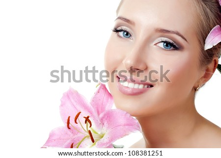 The face of a beautiful girl with a fresh flower lily