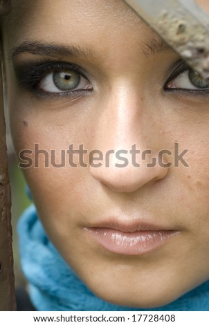 The face of a beautiful green-eyed adult female in the daylight - stock photo