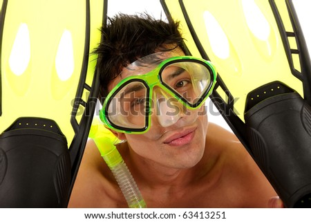 The face of a young Nepalese swimmer with goggles and snorkel and his flippers. Studio shot. White background - stock photo
