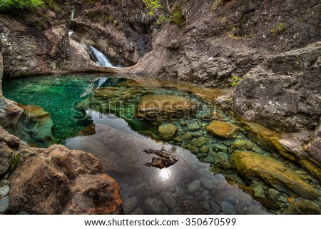 The Fairy Pools on the Isle of Skye in Scotland, United Kingdom on an overcast day. - stock photo