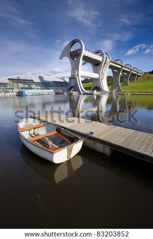 The Falkirk Wheel, a rotating boat lift linking the Forth and Clyde Canals with the Union Canal in Central Scotland. Opened in 2002, this engineering landmark is the only one of its kind in the world. - stock photo