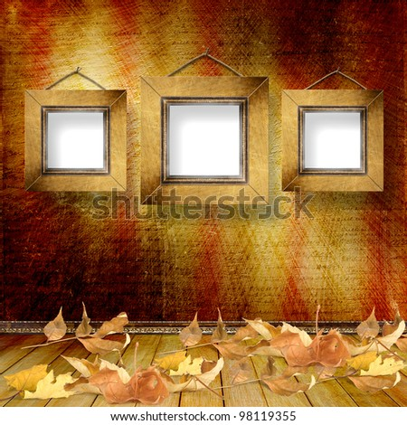 The fallen leaves on the background wall with vintage wallpaper - stock photo