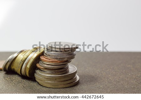 the falling of stack of coins ,Piles of coins - stock photo