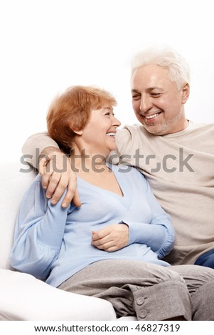 The family couple laughs on a white background - stock photo