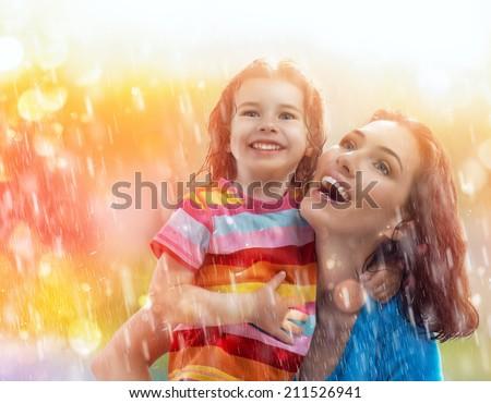 the family enjoys the rain - stock photo