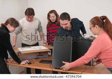 The family has bought the new computer and prepares it for connection. - stock photo