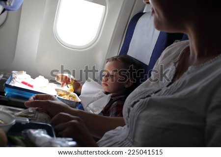 The family has lunch on the flight - stock photo