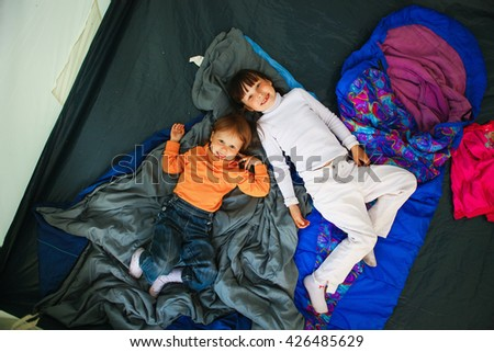 The Family resting in nature with a camping. - stock photo