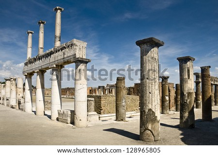 The famous antique site of Pompeii, near Naples in Italy. This is part of the forum.It was completely destroyed in 79BC by the eruption of Mount Vesuvius. - stock photo