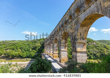 The famous aqueduct from Roman times Pont du Gard. Summer in Provence, sunny day - stock photo
