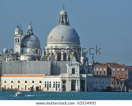 The famous basilica of Santa Maria della Salute, on the grand canal in Venice, built in the palladian style as an offering for protection from the plague - stock photo