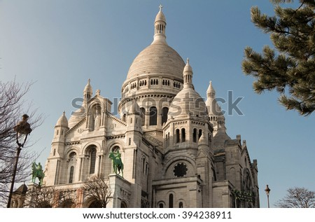 The famous basilica Sacre Coeur  is a Roman catholic church located on the butte Montmartre in Paris, France. - stock photo