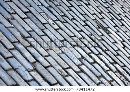 The famous blue tinted cobblestone lined streets of historic Old San Juan Puerto Rico. - stock photo