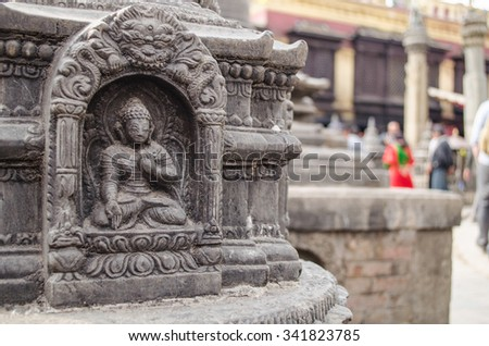 the famous buuha eye gazing out sleepily from each side of the tower are those of the all seeing primordial buddha.perched a top a hill on the western edge of the kathmandu valley. - stock photo