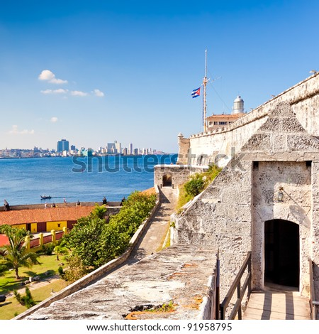The famous castle and lighthouse of El Morro in Havana with a view of the city - stock photo