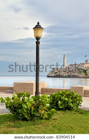 The famous castle of El Morro in Havana seen from a beautiful park across the bay - stock photo