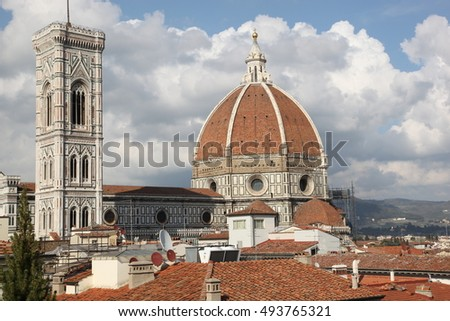 The famous Cathedral of Santa Maria del Fiore, Florence, Italy. - The centuries-old cathedral meets a new day in the new century. Redhead tile roofs enjoys the sun and good weather in the city.