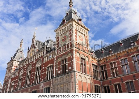 The famous Central Railway station in the old city center of Amsterdam - stock photo