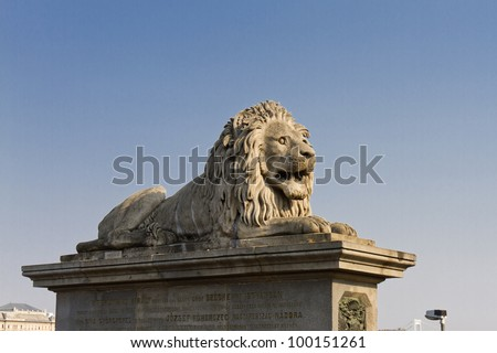 The famous Chain Bridge across the Danube in Budapest, Hungary, Europe. Lion statue. - stock photo