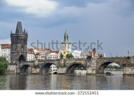 The famous Charles Bridge and the Old Town Bridge Tower. On the right is the old Prague water tower. View from Vltava river. Czech Republic