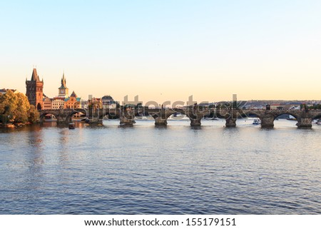 The famous Charles bridge in Prague at sunset