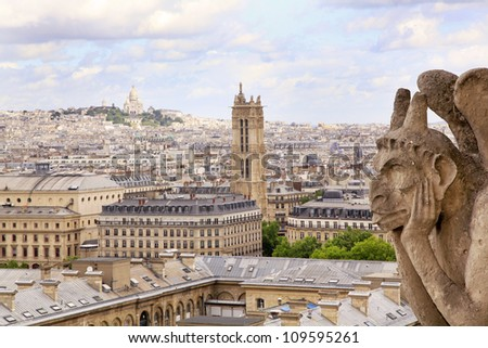 The famous Chimera overlooking the Sacre-Coeur Basilica and Paris skyline - stock photo