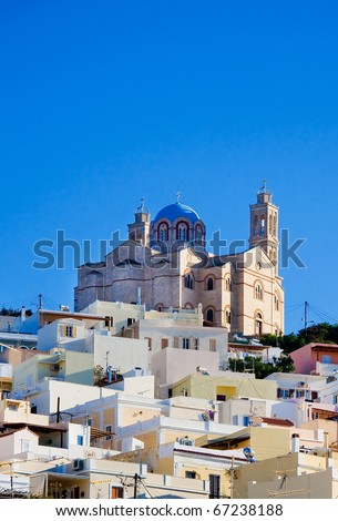 The famous church on the island of Syros, surrounded by houses on the hill. Typical of the Greek islands. - stock photo
