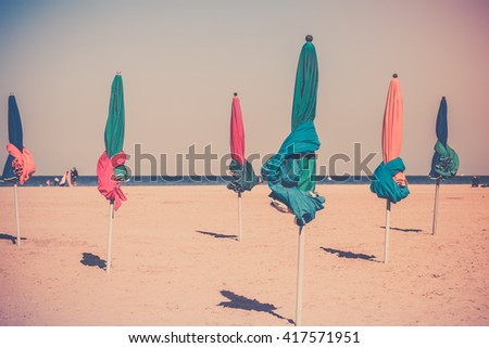 The famous colorful parasols on Deauville beach, Normandy, Northern France - stock photo