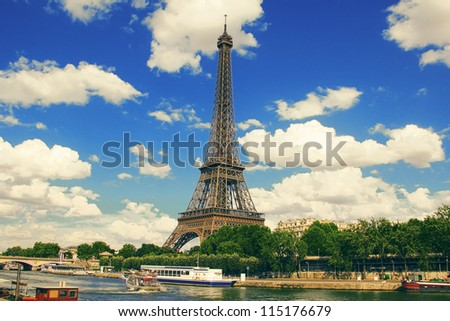 The famous Eiffel Tower on a sunny day in Paris, France. HDR - stock photo