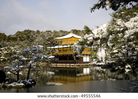 the famous golden temple in the snow - stock photo