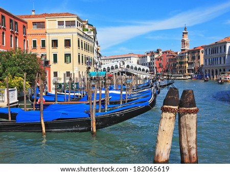 The famous Grand Canal in Venice. Graceful black gondolas wait for passengers on the mooring at the palace. Photo taken by lens Fisheye - stock photo