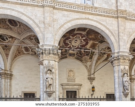 """The famous house """"Loggia della Mercanzia"""" in Siena Italy, detail of the frescoes of the vault - stock photo"""