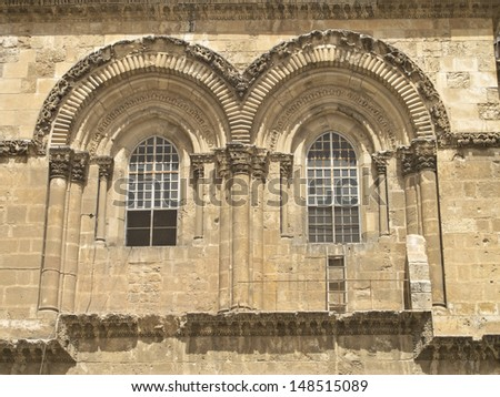 The famous immovable ladder on the Church of the Holy Sepulchre in the old city of Jerusalem, Israel. - stock photo