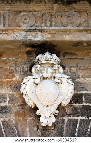The famous lion carved into the entrance of the historic El Morro fort located in Old San Juan Puerto Rico. - stock photo