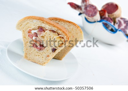 The famous neapolitan salty bread stuffed with salami and cheese called Casatiello and prepared for Easter. - stock photo