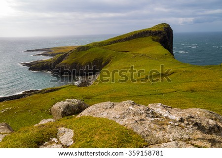 The famous Neist Point on the Isle of skye on a cloudy afternoon - Scotland, UK - stock photo