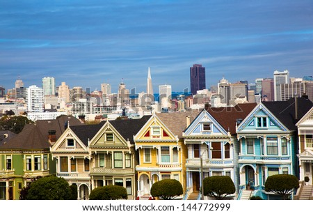 The famous painted ladies house in San Francisco California with skylin - stock photo