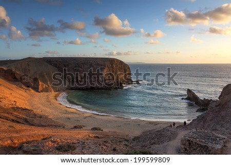 The famous Papagayo Beach on the Lanzarote Island in the Canary Islands Arhipelago, Spain at sunset time. - stock photo