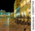 The famous Plaza Vieja Square in Old Havana illuminated at night - stock photo