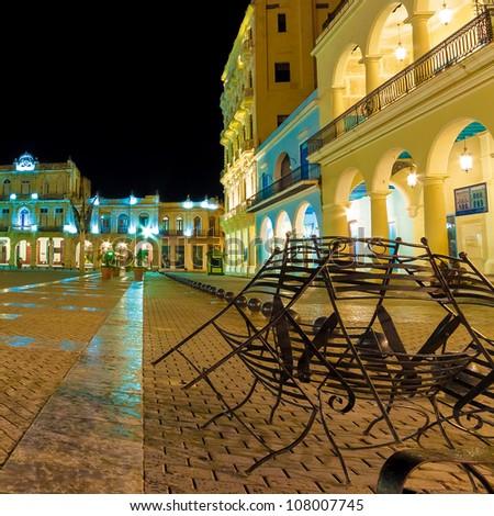 The famous Plaza Vieja Square in Old Havana illuminated at night - stock photo