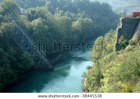 the famous railway bridge over the river neretva in bosnia herzegovina. this bridge was blown up by Marshal tito as a decoy against a German encirclement. - stock photo