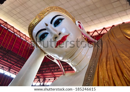 the famous reclining buddha in Myanmar - stock photo