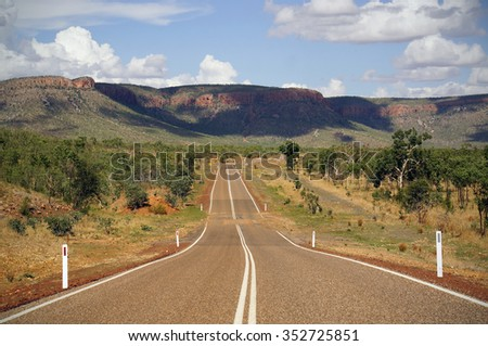 The famous rugged Gibb River Road in the Kimberley, Western Australia crossing remote and pristine wilderness.                                - stock photo