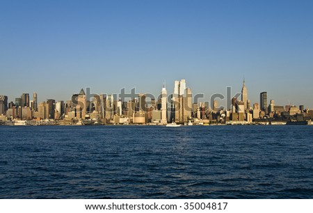 The famous skyline of Manhattan, as seen from New Jersey, at sundown. - stock photo