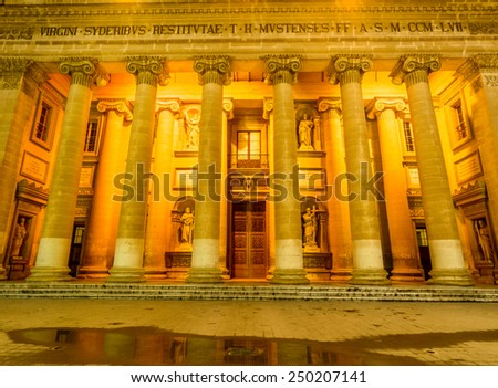 The Famous St Mary's Church in Mosta in Malta sometimes known as the Rotunda of Mosta or the Mosta Dome. It is the third largest dome church in Europe. Church facade at the twilight - stock photo