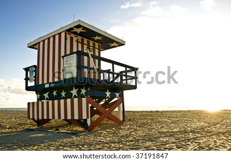 The famous 13th Street Lifeguard hut of South Beach Miami, at sunrise. - stock photo